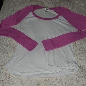 Pink baseball shirt.